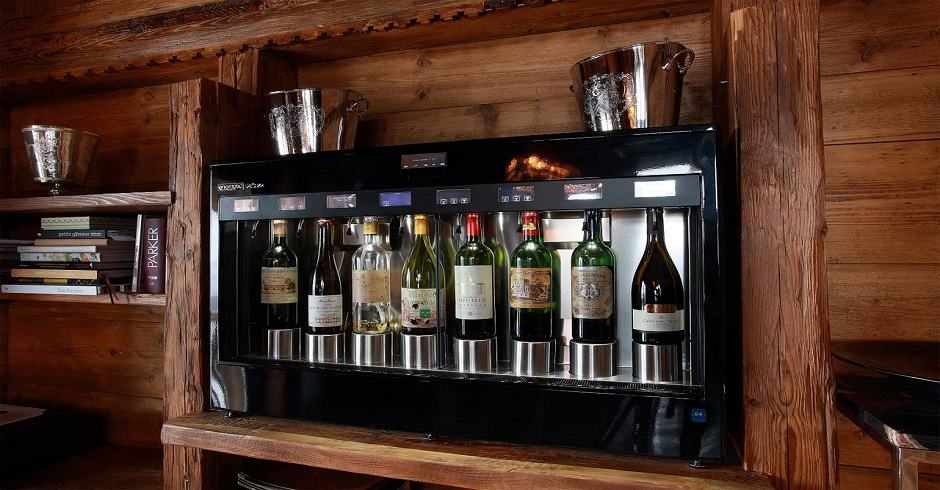 black enomatic wine dispensing system in a bar